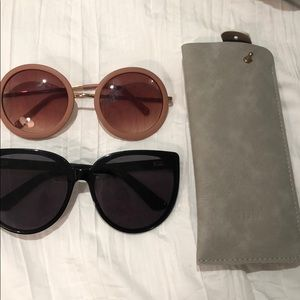2 pairs of sunglasses and a case
